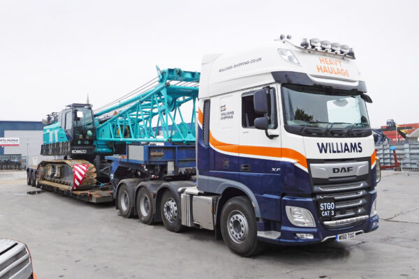 Williams Shipping heavy haulage truck carrying a crawler crane