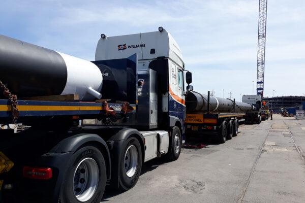 Convoy of Williams Shipping trucks transporting spud legs
