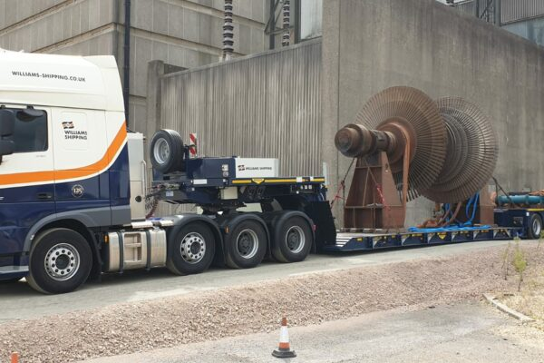 Large mechanical equipment on the trailer of a heavy haul truck