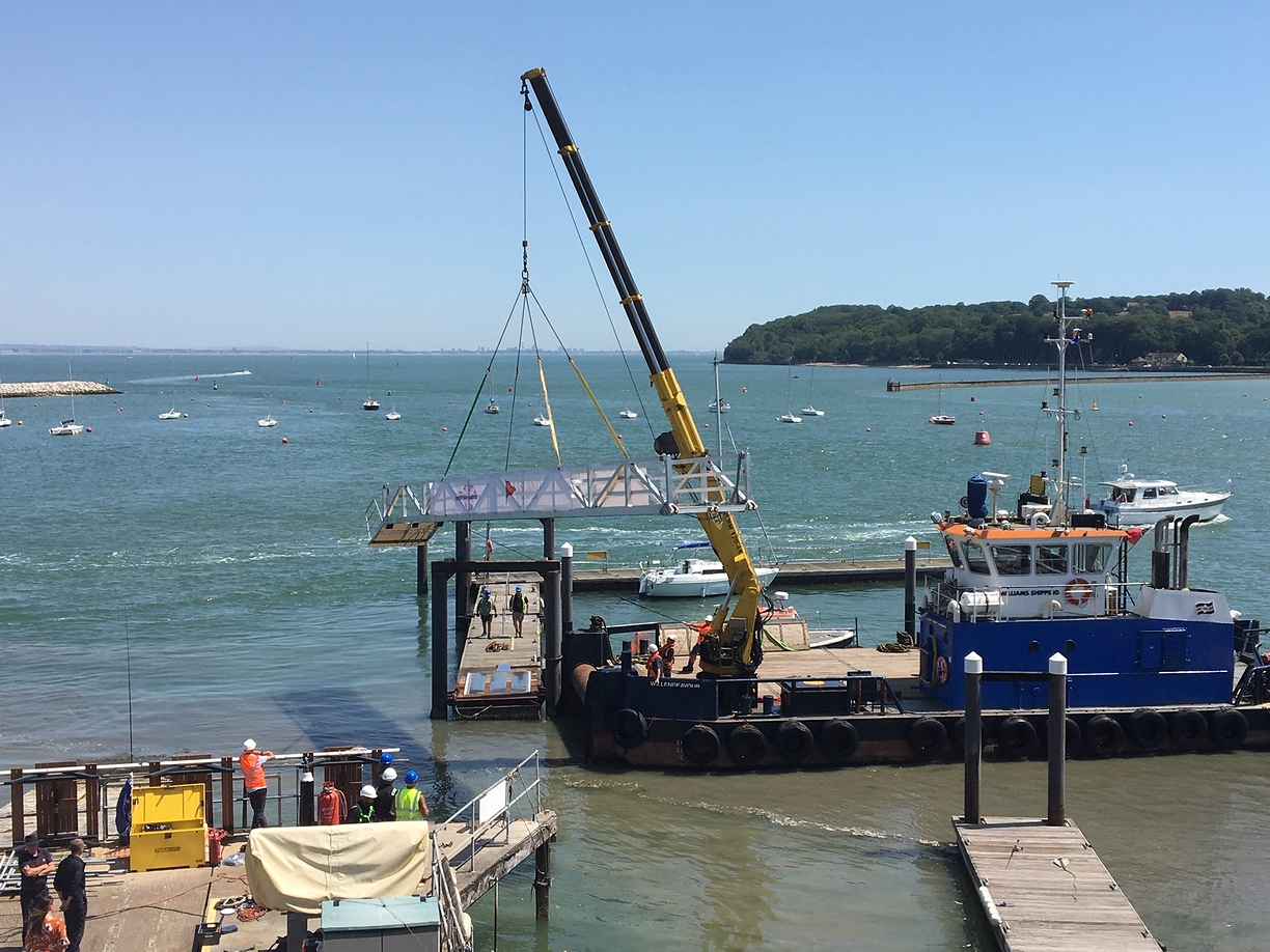 Wilendeavour lifting a pontoon bridge into place for the ISC